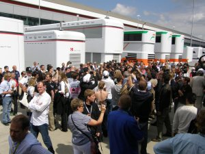 media-scrum-silverstone-paddock-2011