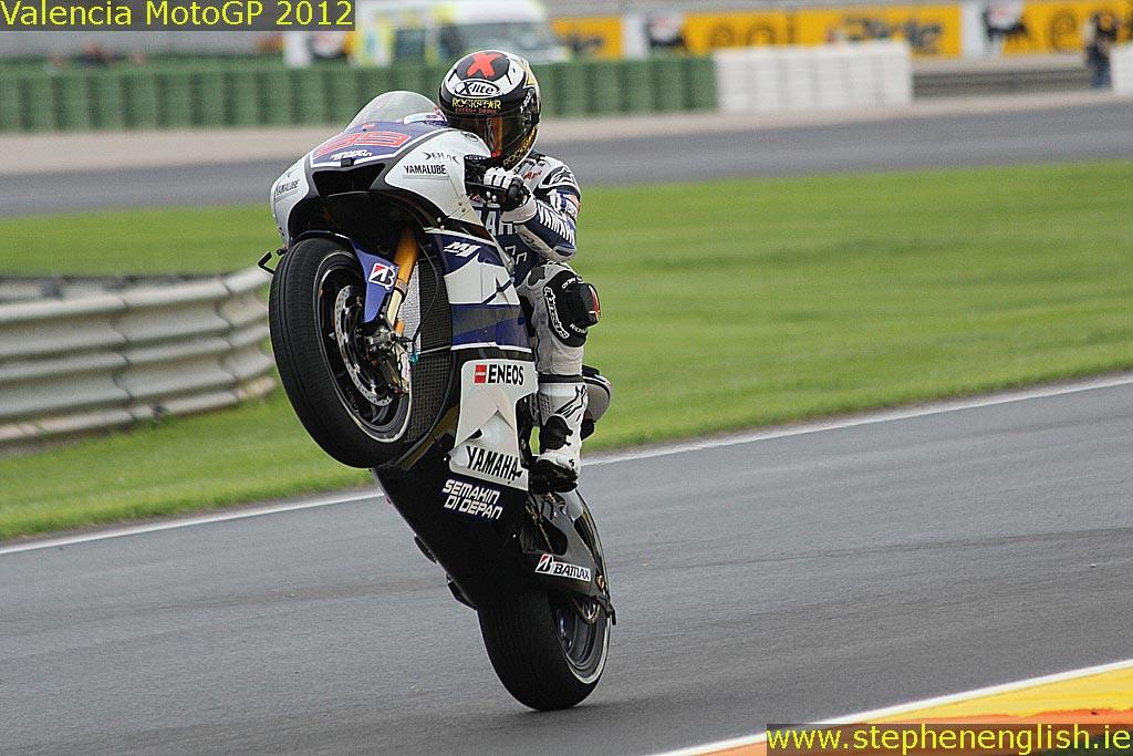 Motogp 2013 promises an exciting season stephen english jorge lorenzo wheelie valencia fp2 2012 voltagebd Images