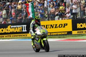 Andrea-Iannone-celebrates-Italian-flag-Assen-Moto2-Race-2012